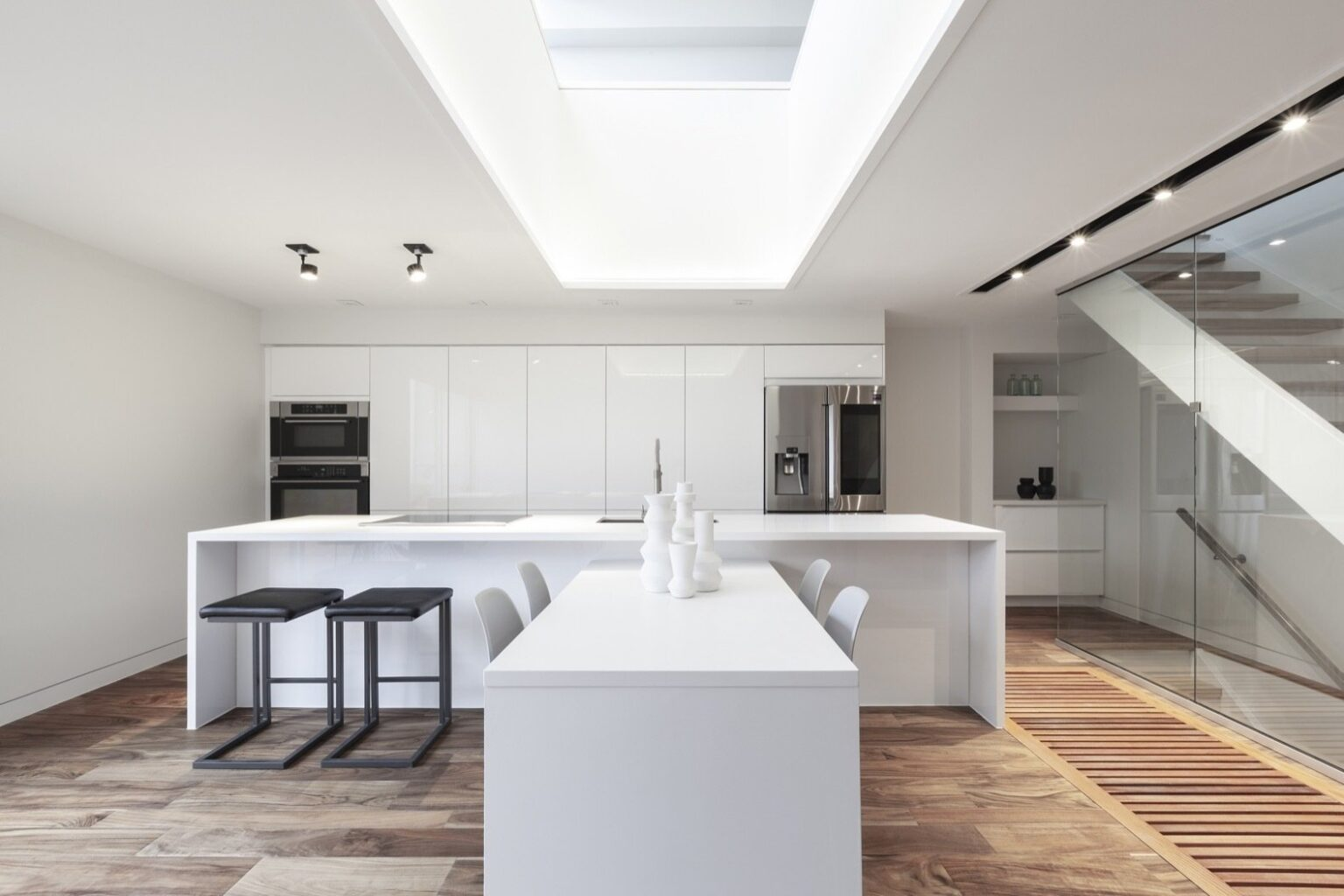 for-a-clean-and-bright-finish-the-light-filled-kitchen-is-fitted-with-white-quartz-countertops-and-high-gloss-white-ikea-cabinetry