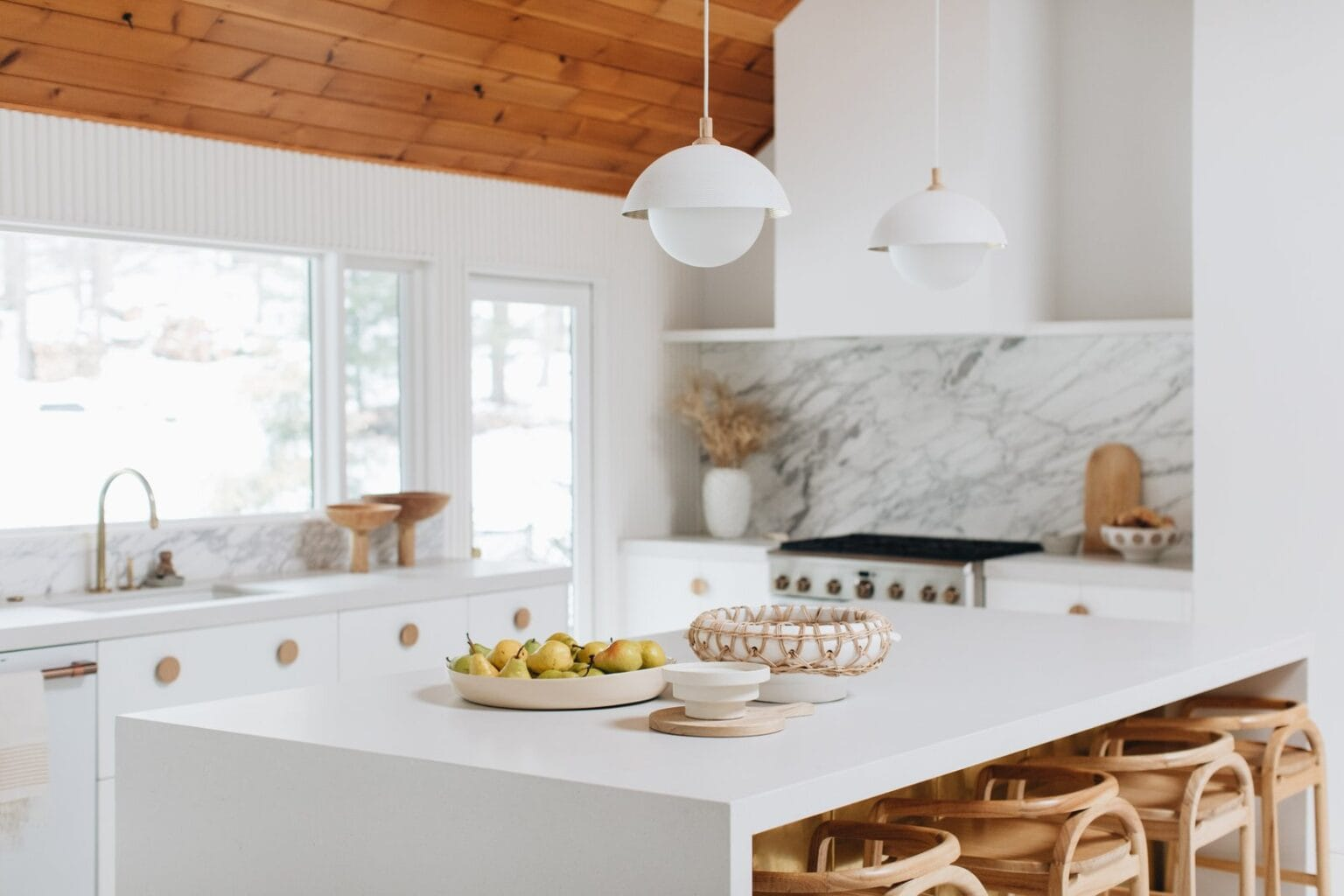 the-whole-exterior-wall-of-the-kitchen-was-re-framed-to-include-two-glass-doors-and-one-extra-long-picture-window-to-bring-in-an-abundance-of-natural-light